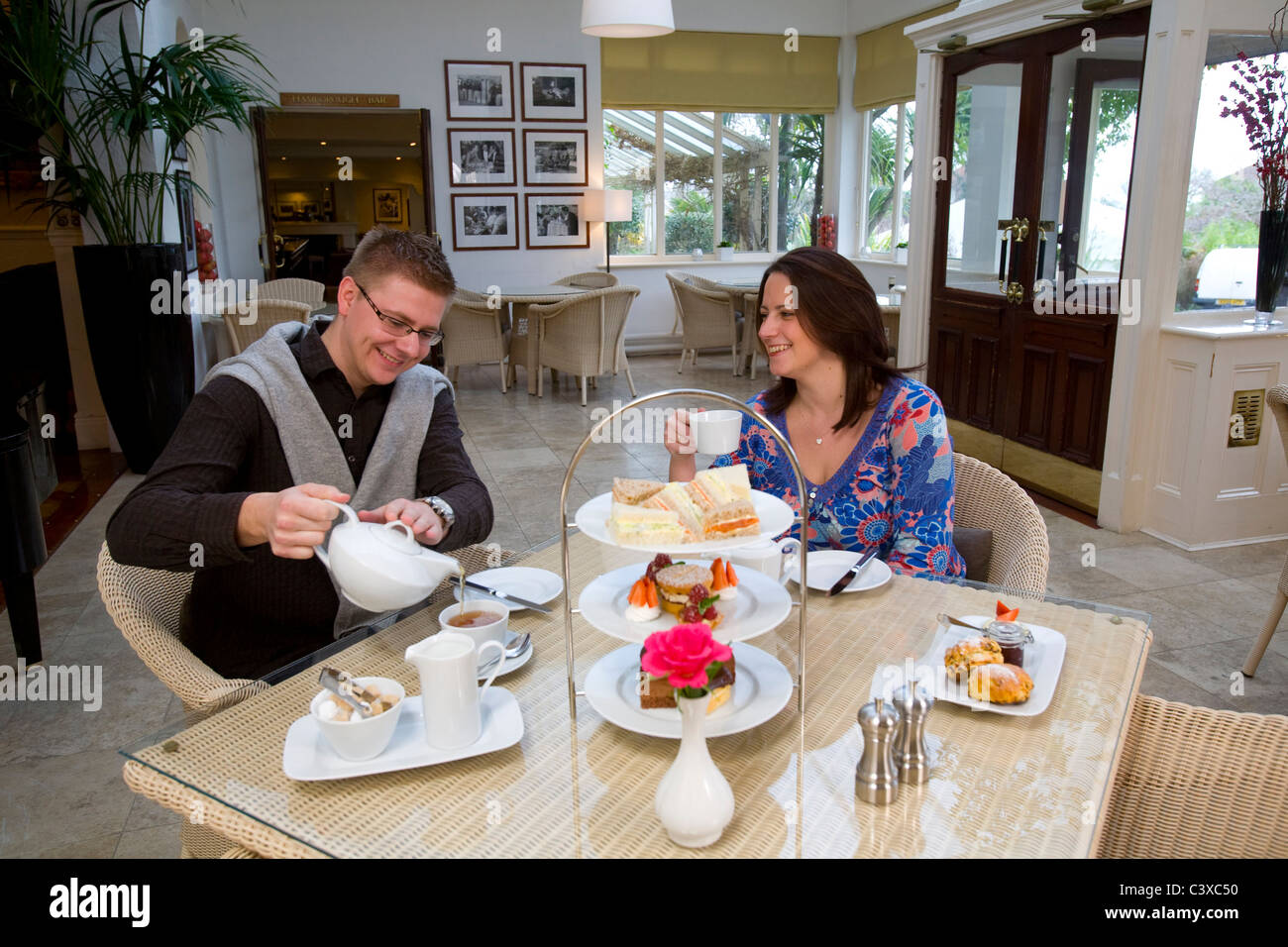 Man, Woman, Taking, Afternoon Tea, Cakes, Scones, Tea, Pastries, Royal Hotel, Ventnor, Isle of Wight, England, UK, - Stock Image