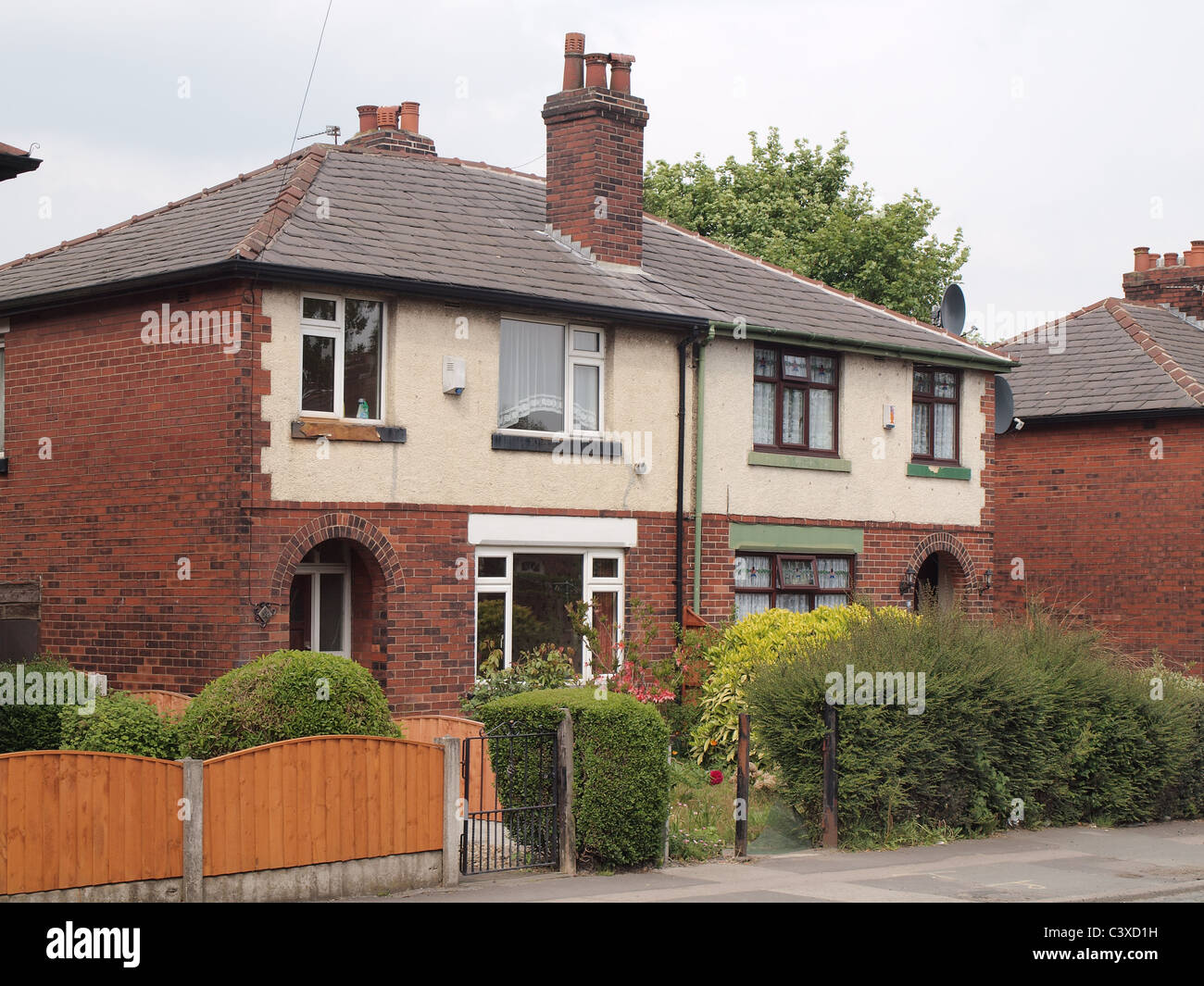 Semi-detached 1930s house in Farnworth; part of the Flower Estate. Originally Council housing stock, many now privately - Stock Image