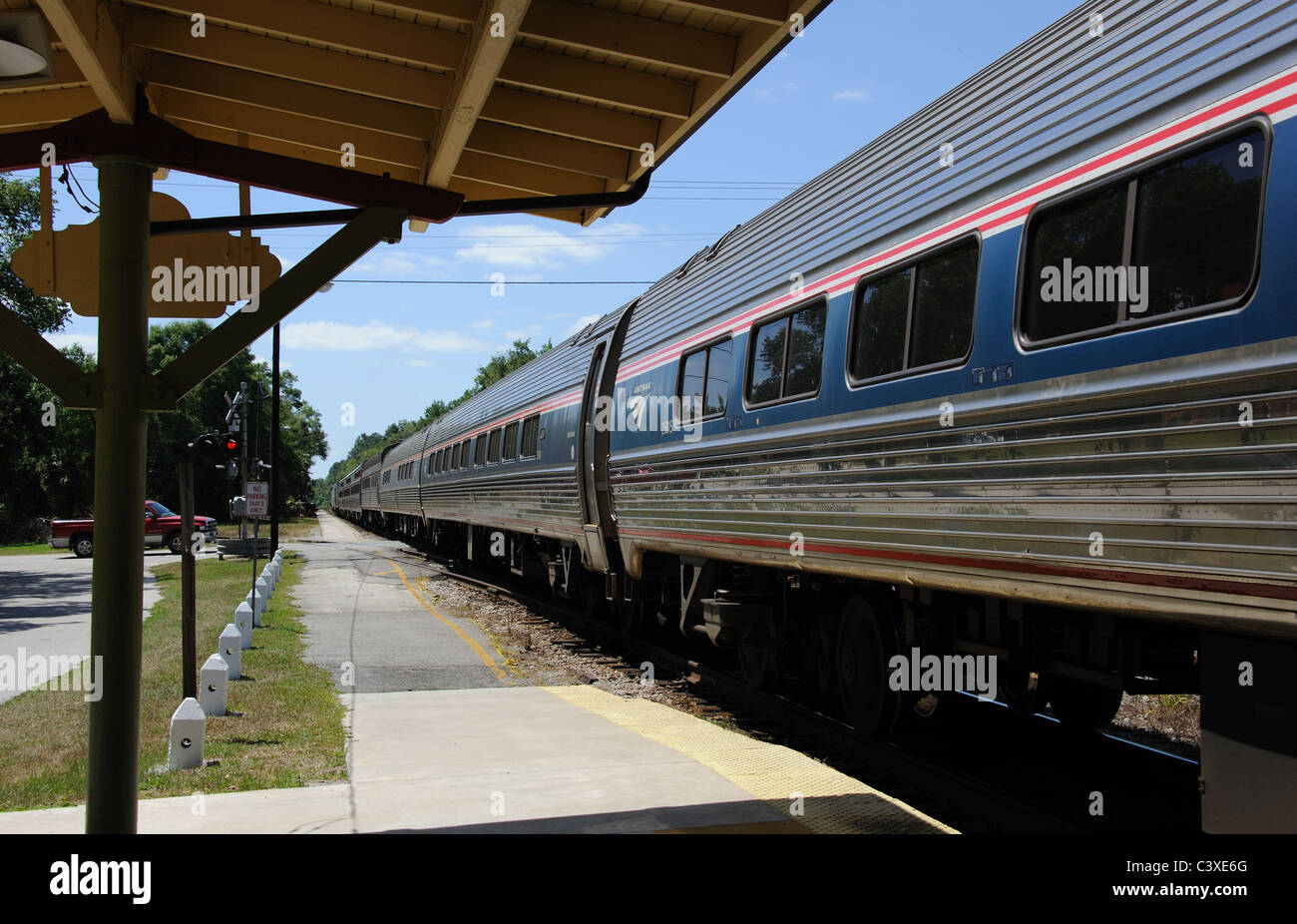 AMTRAK Silver Meteor passenger train departs Deland Railroad Station Florida USA bound for Miami on the Atlantic - Stock Image