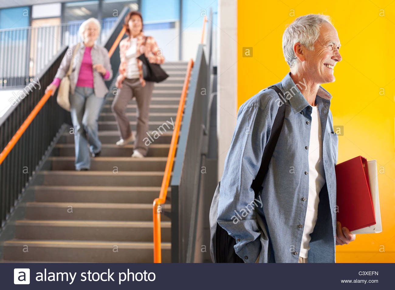 Adult students in college arriving for evening classes - Stock Image