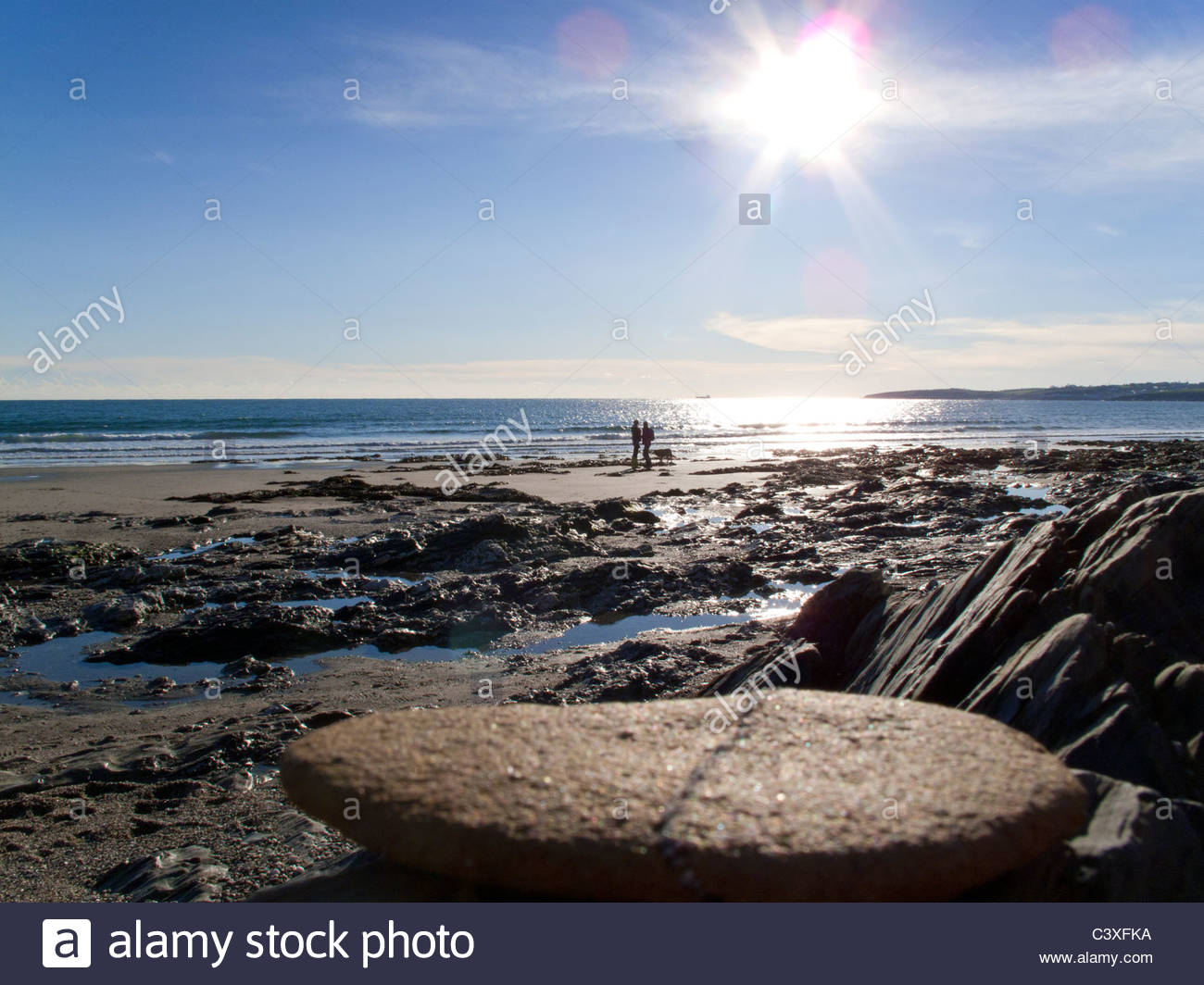 People enjoying rocky beach, Cornwall, United Kingdom - Stock Image