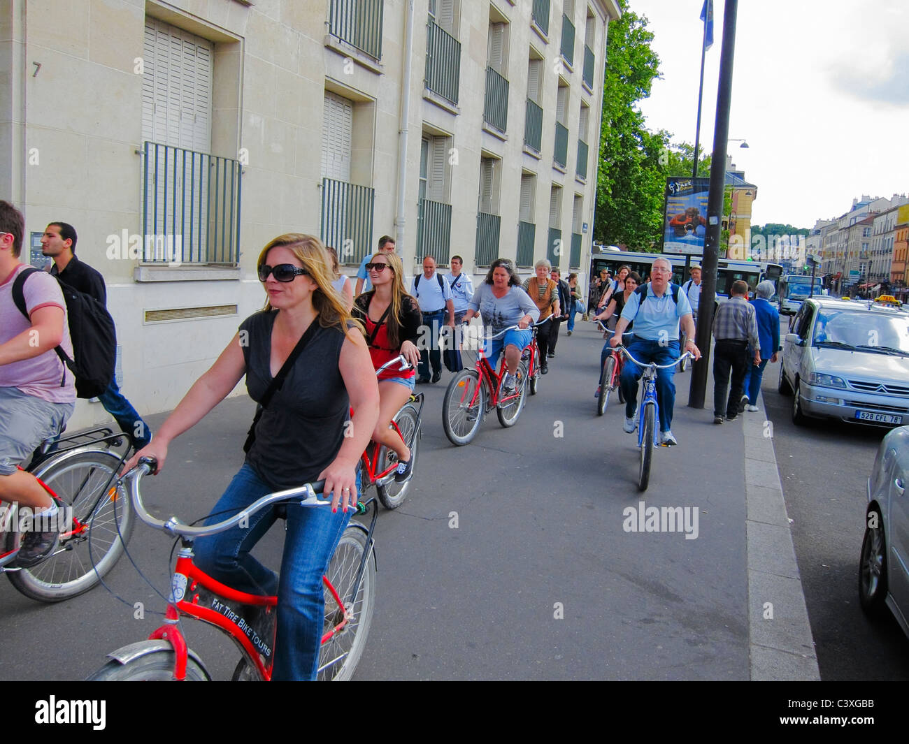 Ver-sailles, France, Urban Street Scenes, Group  Tourists Riding Rented Bicycles, bicycling - Stock Image