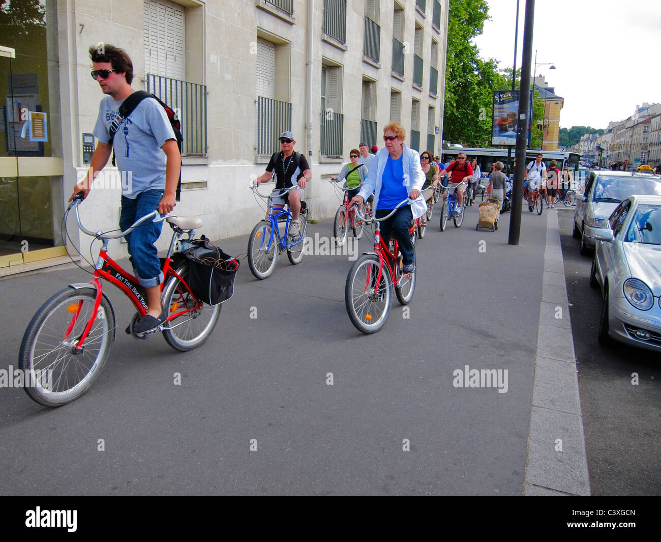 Versailles, France, Urban City Street Scenes, Group Cycling Tourists Riding Rented Bicycles bicycling on Sidewalk - Stock Image