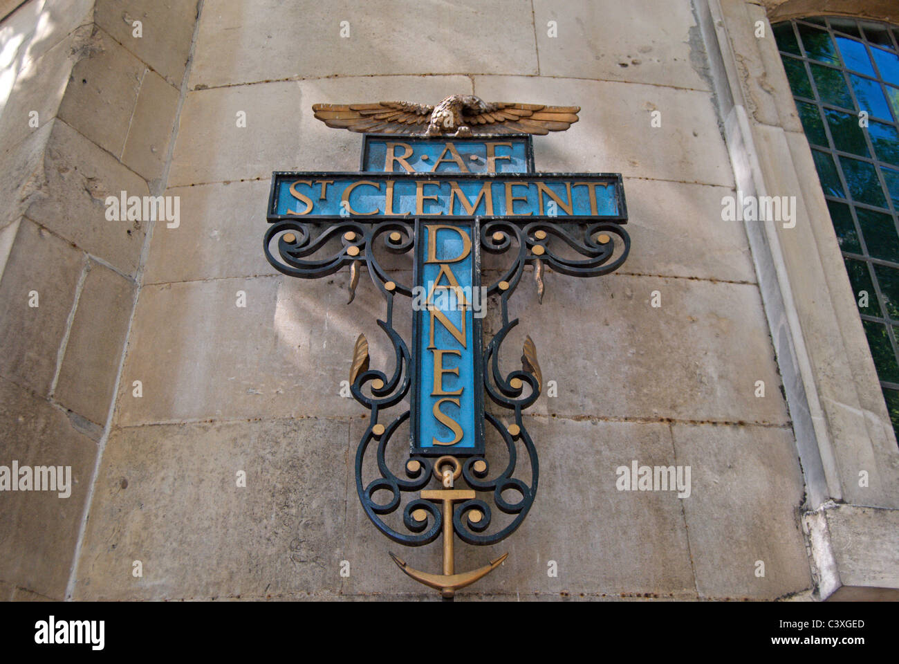 cross of the crucifixion bearing the name of the church of st clement danes, the raf church, in fleet street, london, - Stock Image