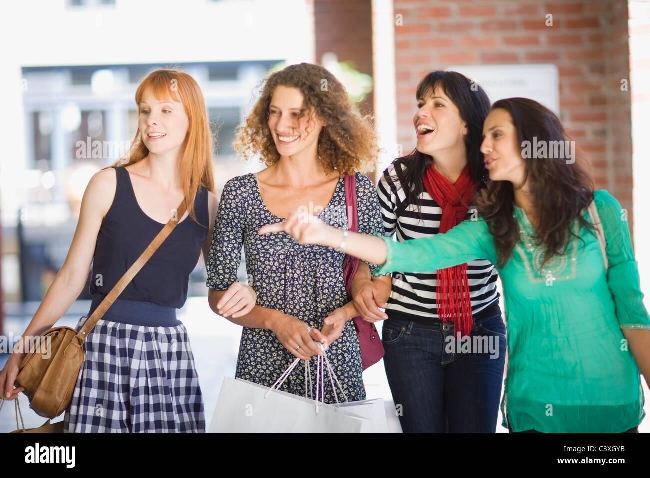 4 Girls on  shoping tour - Stock Image