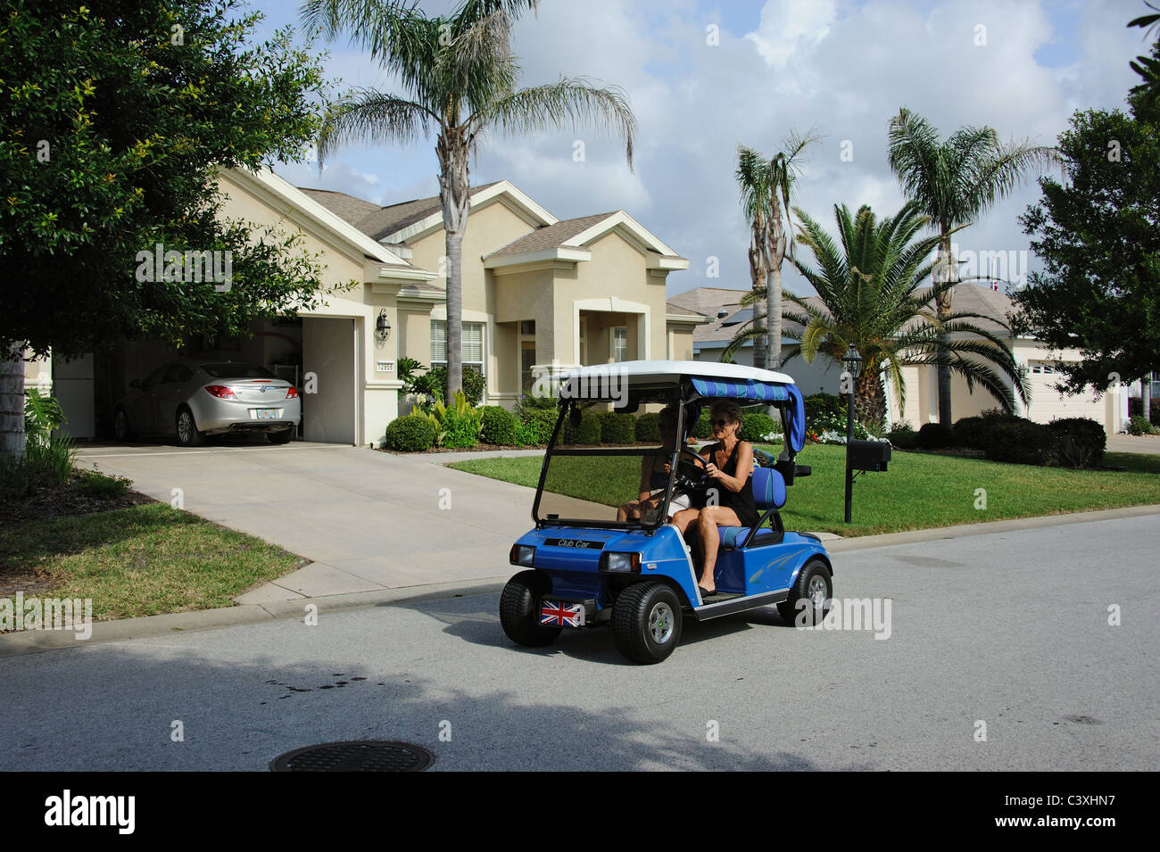 Clubcart being used on a Summerfield Florida residential estate USA - Stock Image