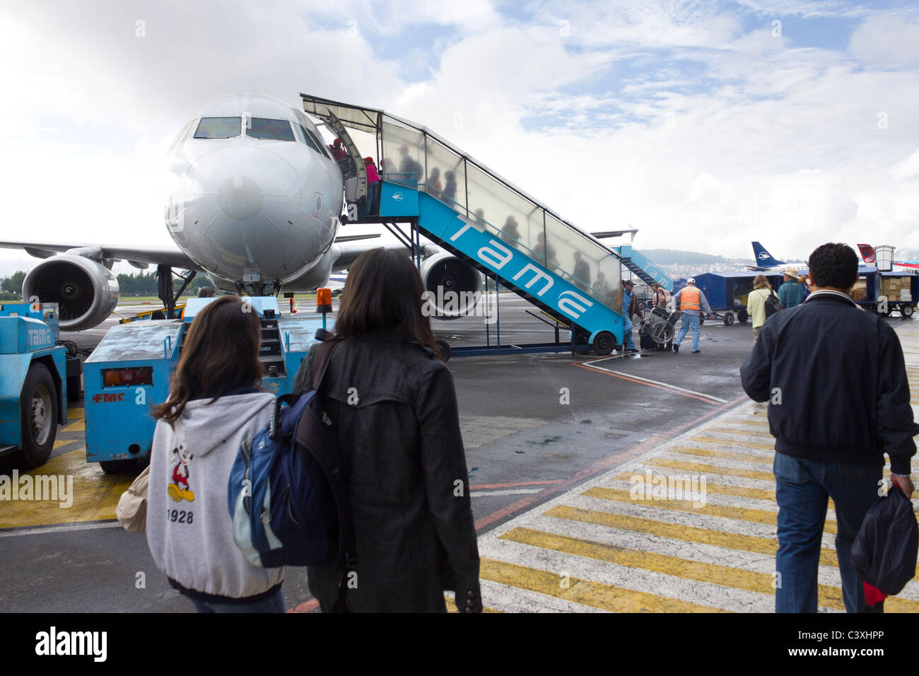tourists departing on Tame flight at Quito  airport, for flight to Galapagos Islands, Ecuador - Stock Image