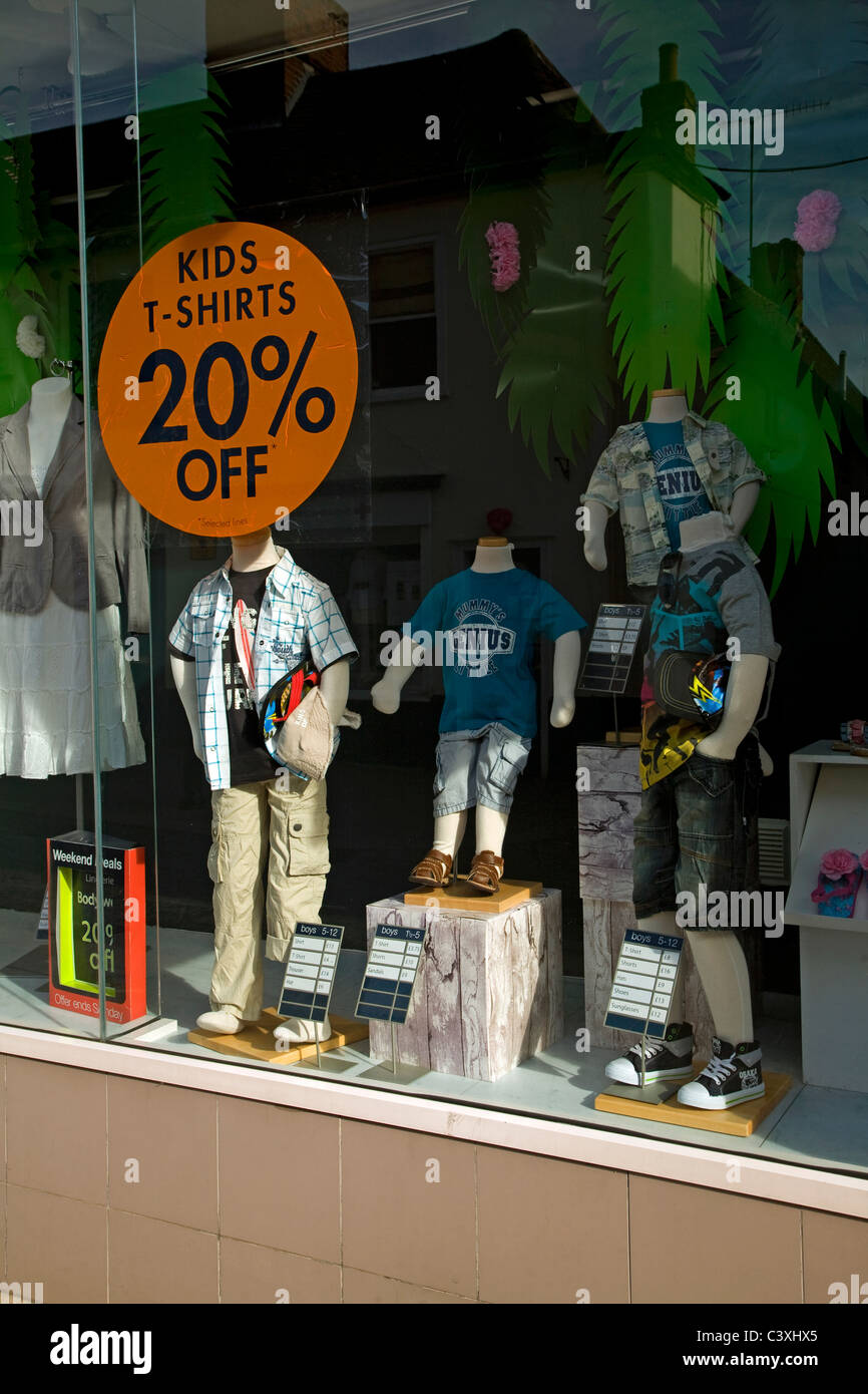 Window display sale reductions children's clothing Woodbridge Suffolk England - Stock Image