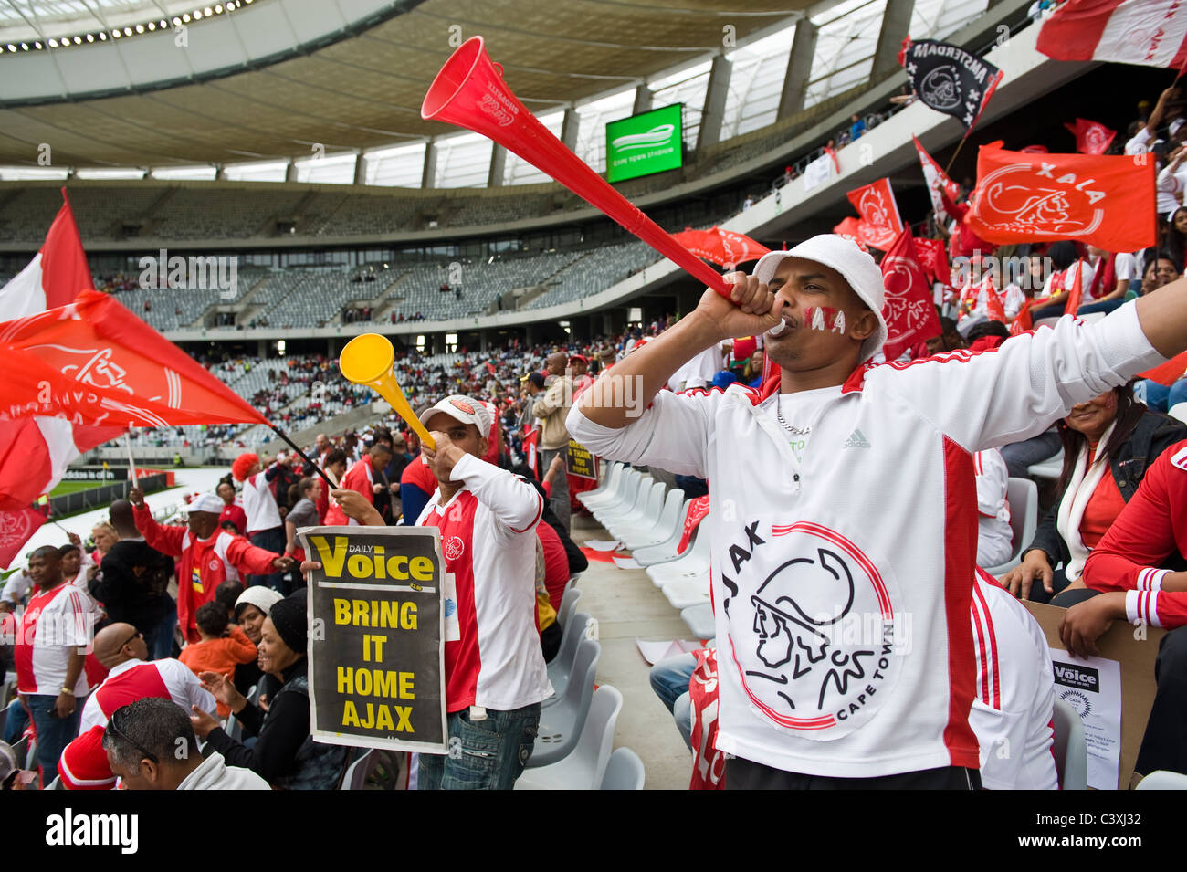 Supporters of Ajax Cape Town Football Club in Cape Town Stadium, Cape Town, Western Cape, South Africa - Stock Image