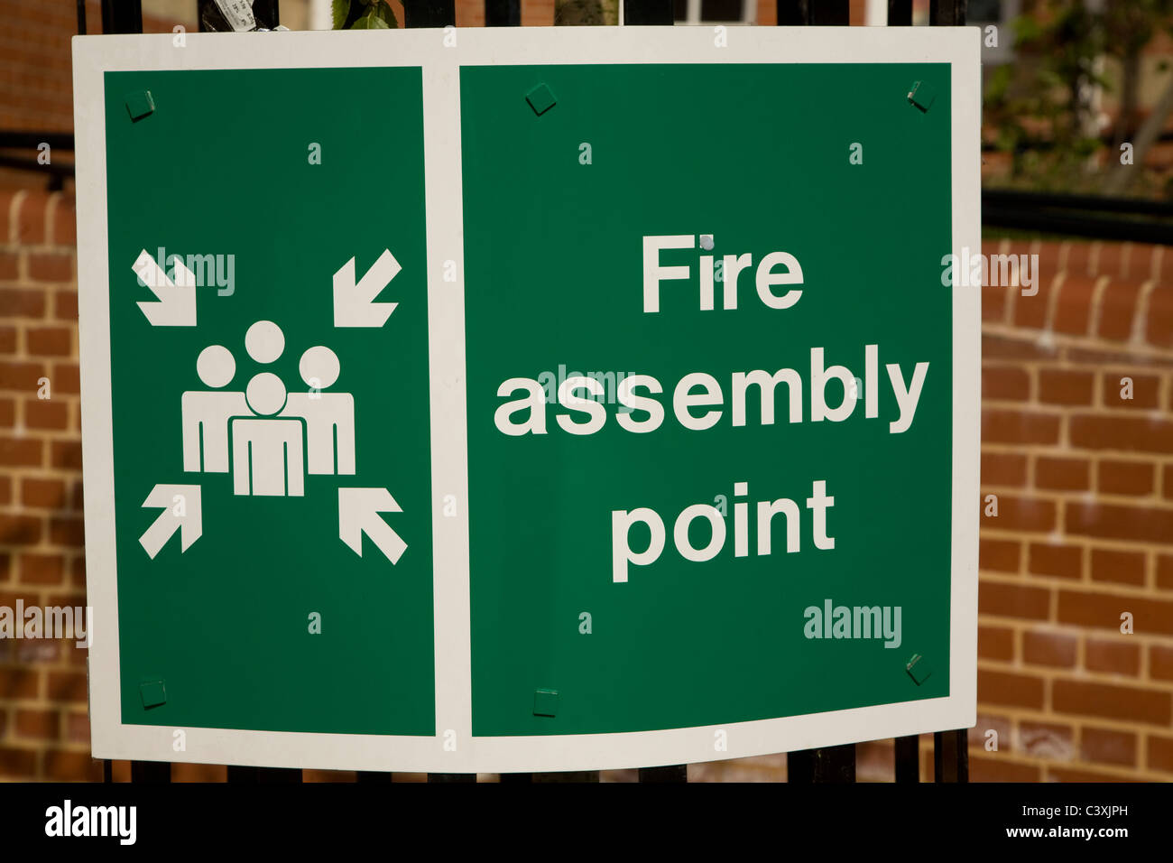 Fire Assembly Point green sign graphic - Stock Image
