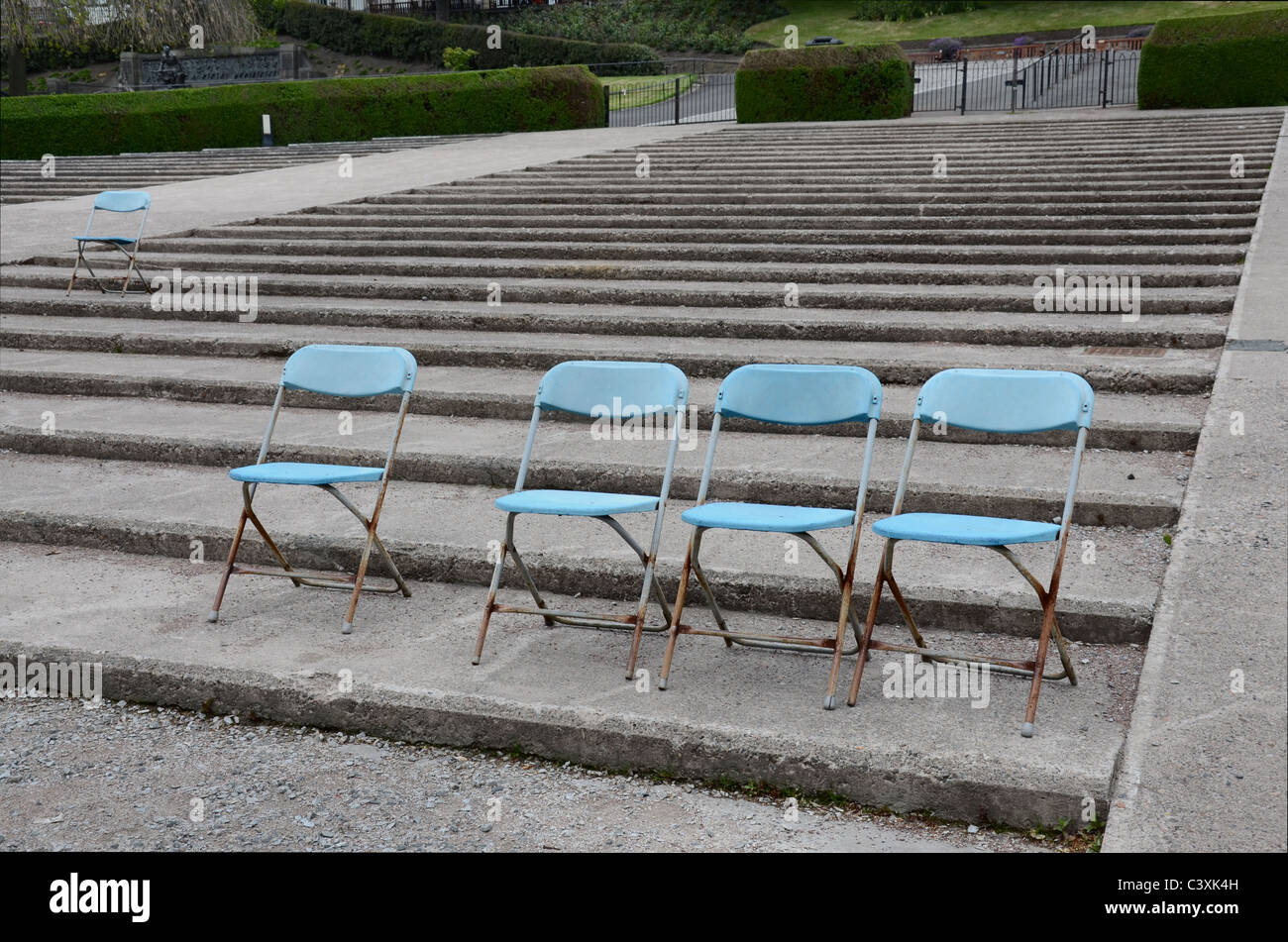 Rusting blue seats at the Ross Bandstand in Princes Street Gardens, Edinburgh, Scotland, UK - Stock Image