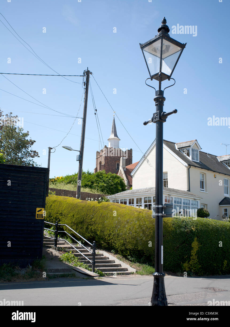 overhead cables in a village - Stock Image