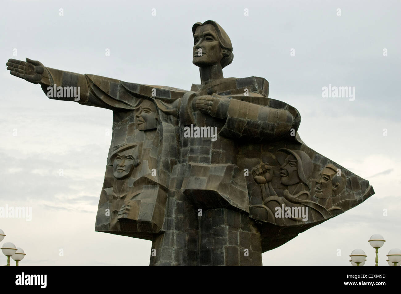 A statue displaying Socialist art. - Stock Image