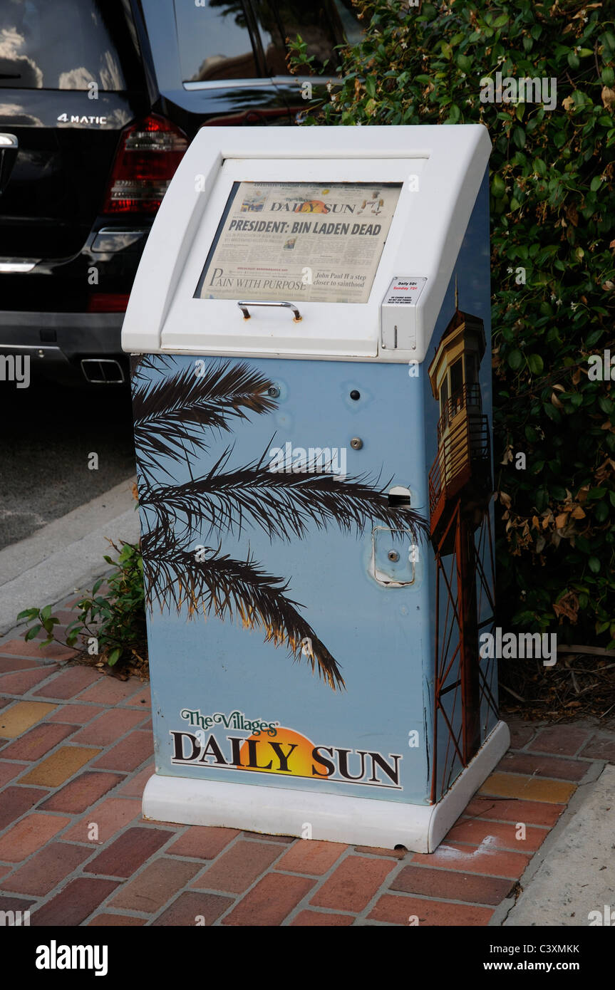 Newspaper vending machine Daily Sun newspaper Florida with headline relating to the death of Bin Laden - Stock Image