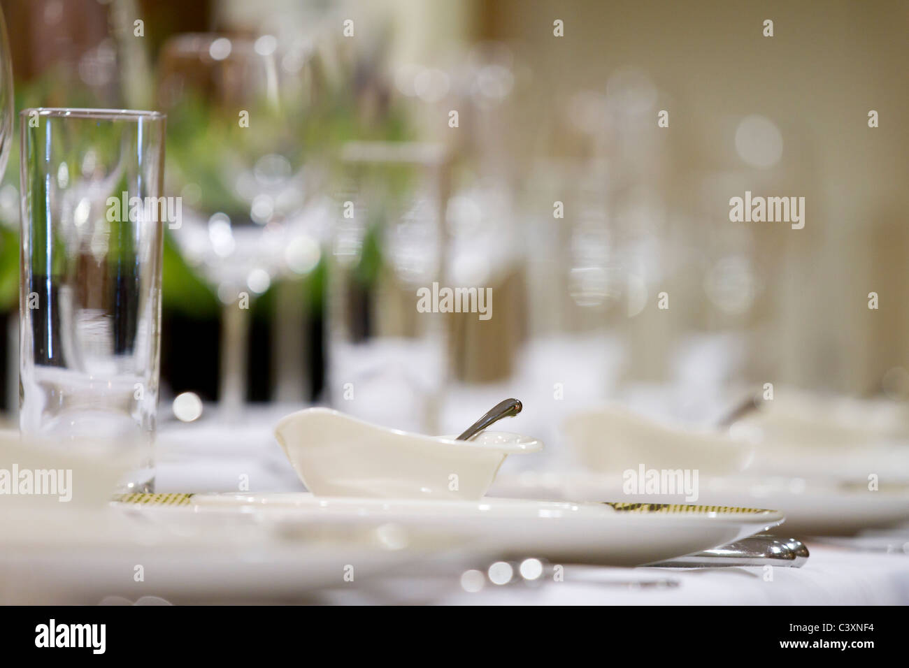 Fine dining restaurant. Wine glasses on a table. - Stock Image