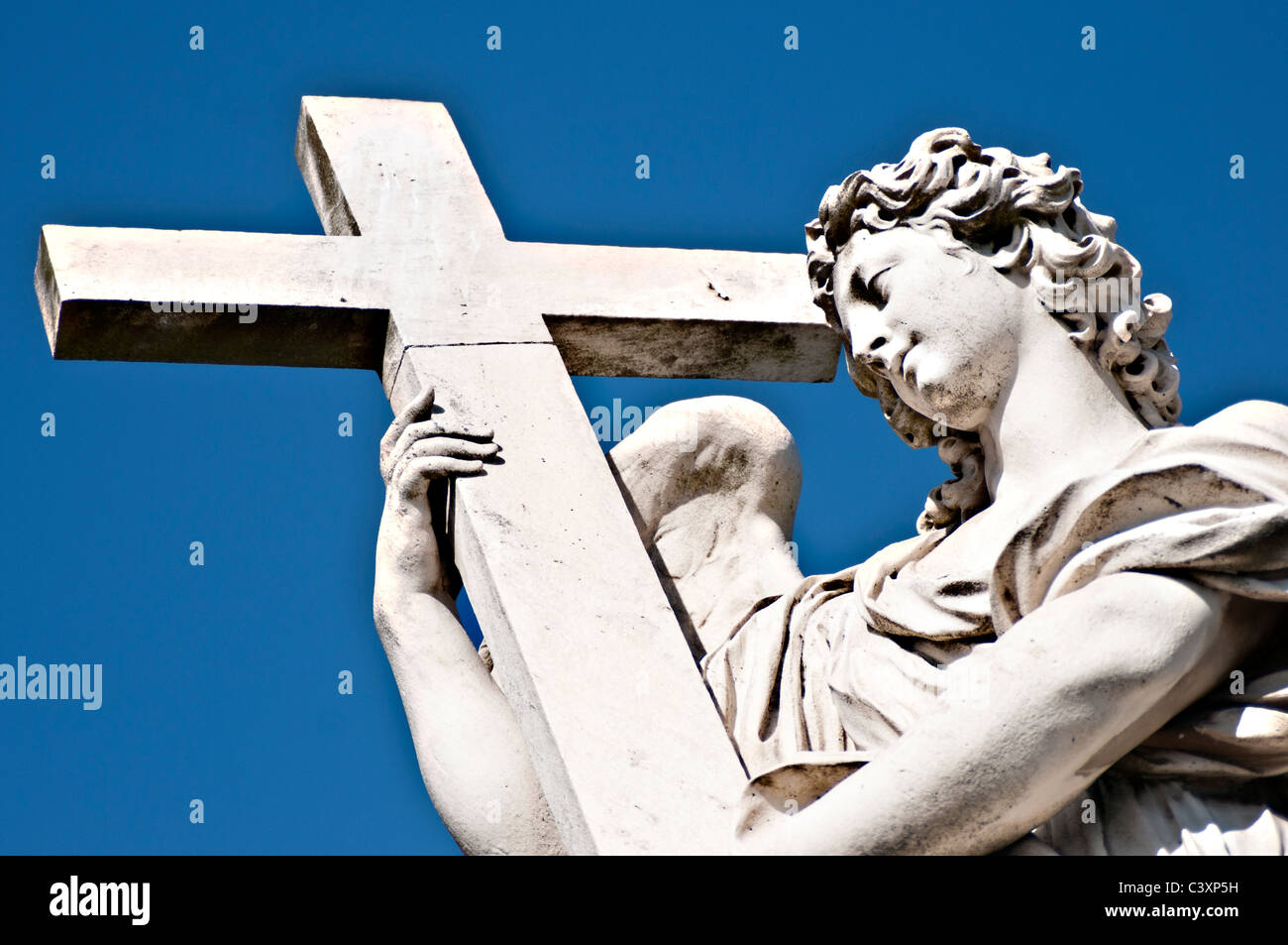 Angel with the Cross- one of the angelsculpures designed by Lorenzo Bernini on Sant Angelo Bridge, Rome Italy - Stock Image