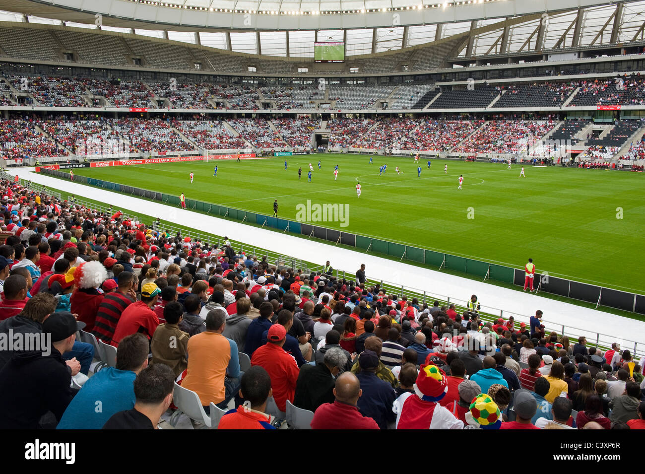 Supports watching a football match in Cape Town Stadium, Cape Town, Western Cape, South Africa - Stock Image