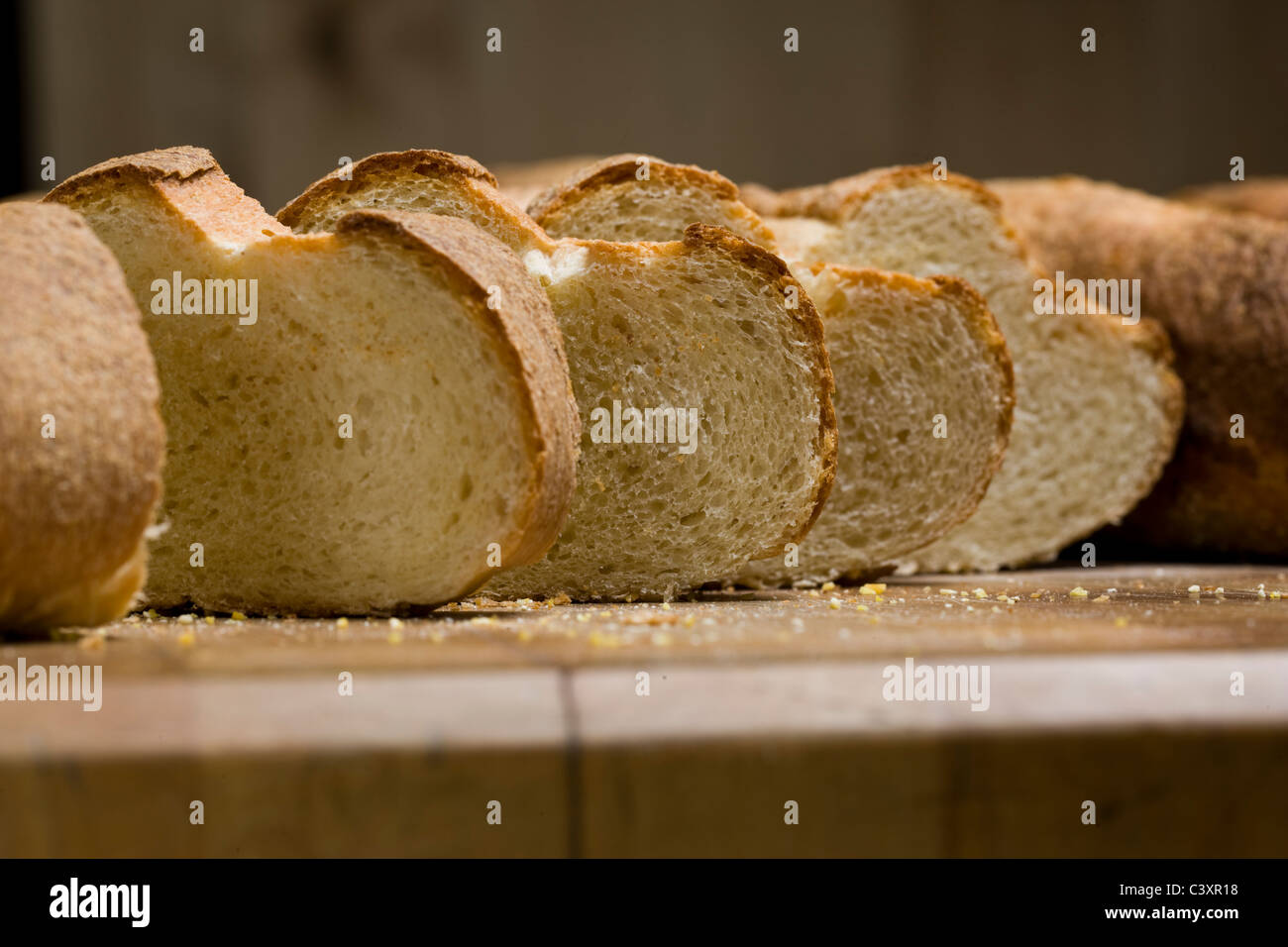 Freshly baked bread for sale in a commercial bakery - Stock Image