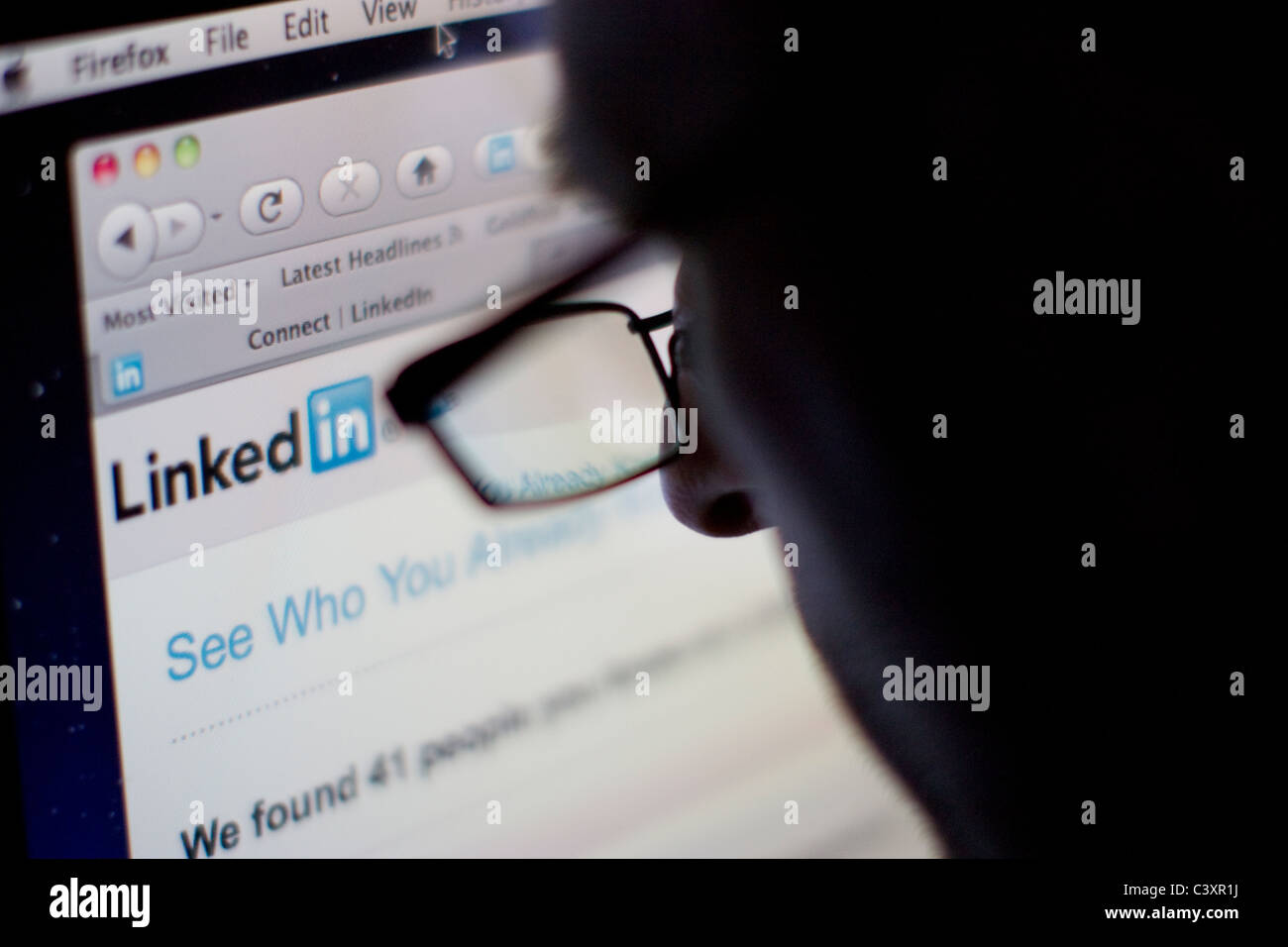 Linkedin linked in website internet proffesional social network site Male surfing linkedin website - Stock Image