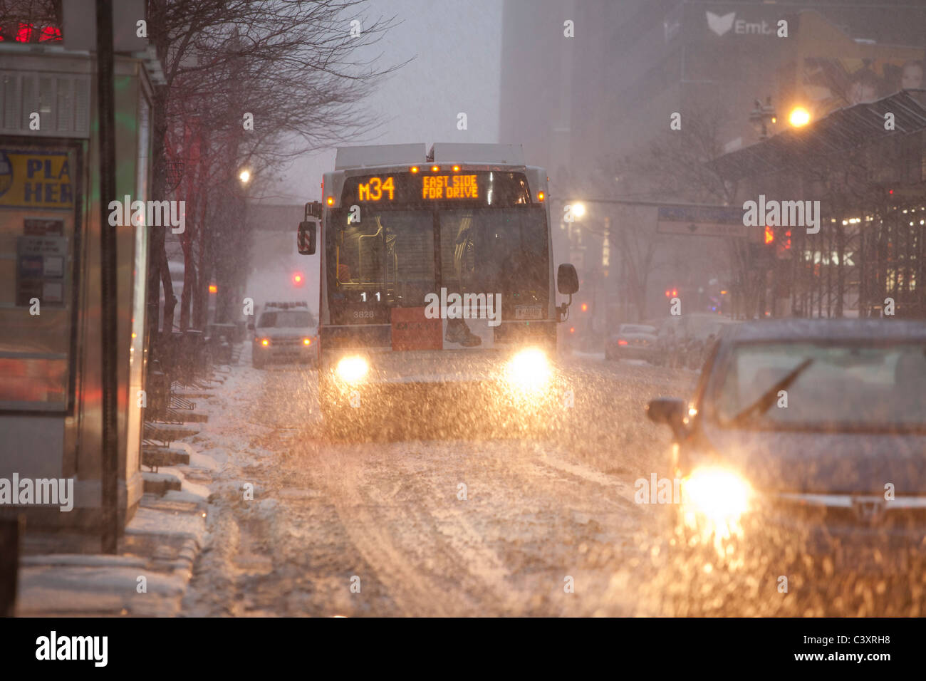 Winter storm 2010, New York City, traffic, headlights in late afternoon - Stock Image