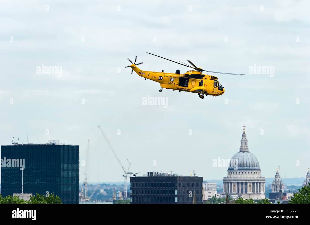 Westland Sea King HAR3A Search and Rescue helicopter from the A-flight, No. 22 Squadron RAF, taking off over London, - Stock Image