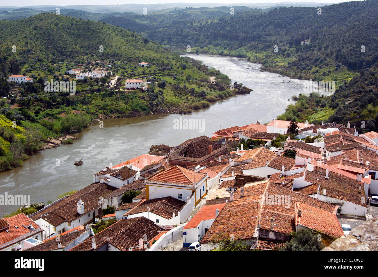 Looking down on the river Guadiana from the pretty little Mértola, Portugal - Stock Image
