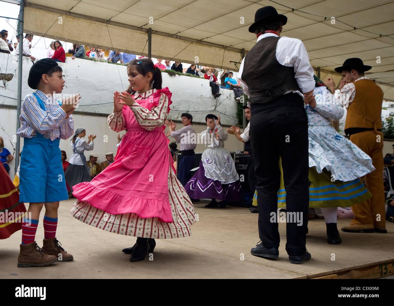 Children dancing during the annual Sardine Festival in Alcoutim Algarve Portugal - Stock Image