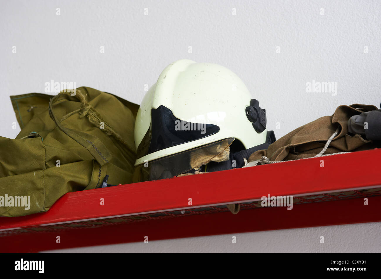 Fire engines, water hoses, nozzles and other equipment at a fire department. Czech Republic Stock Photo