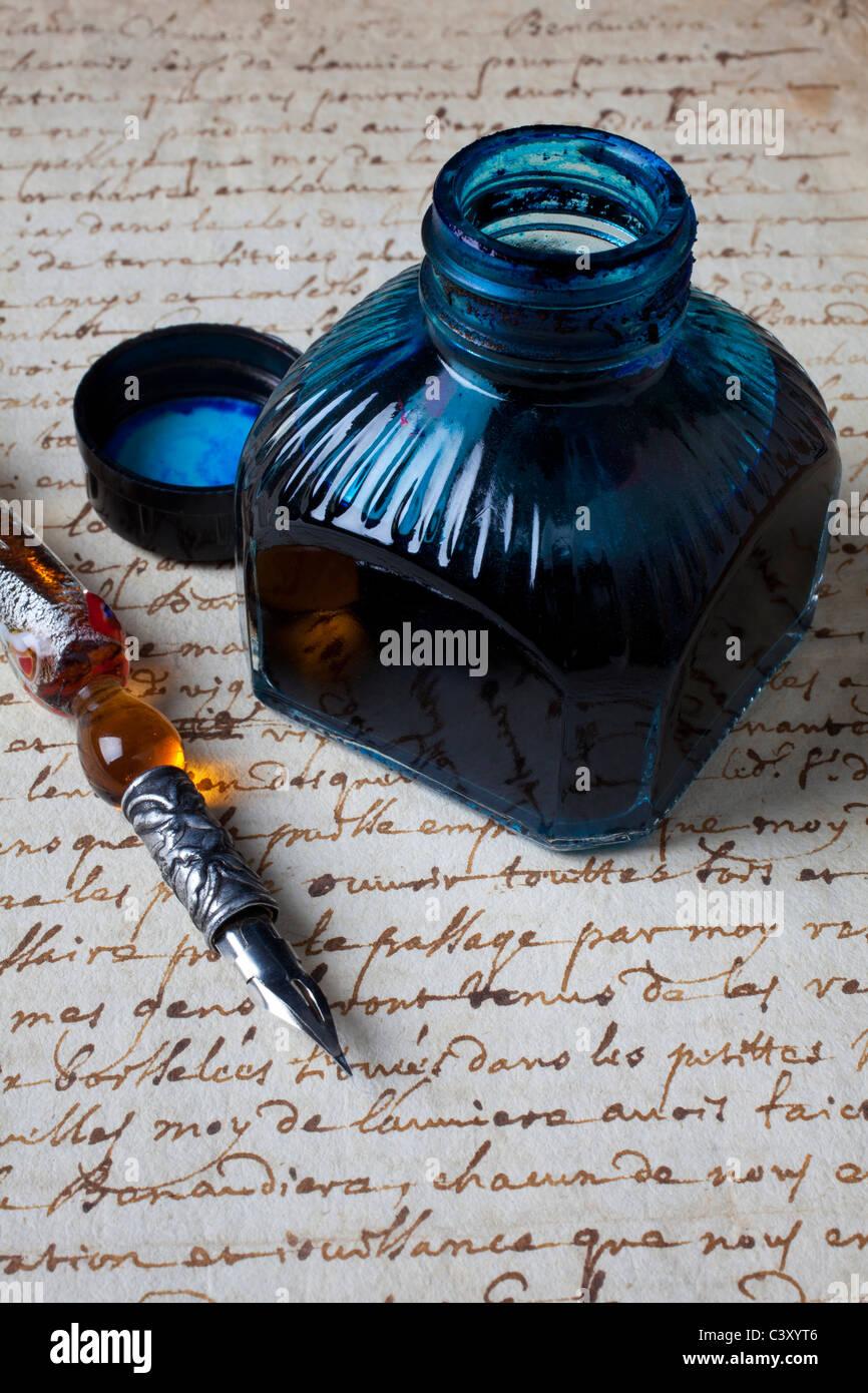 Ink bottle on document - Stock Image