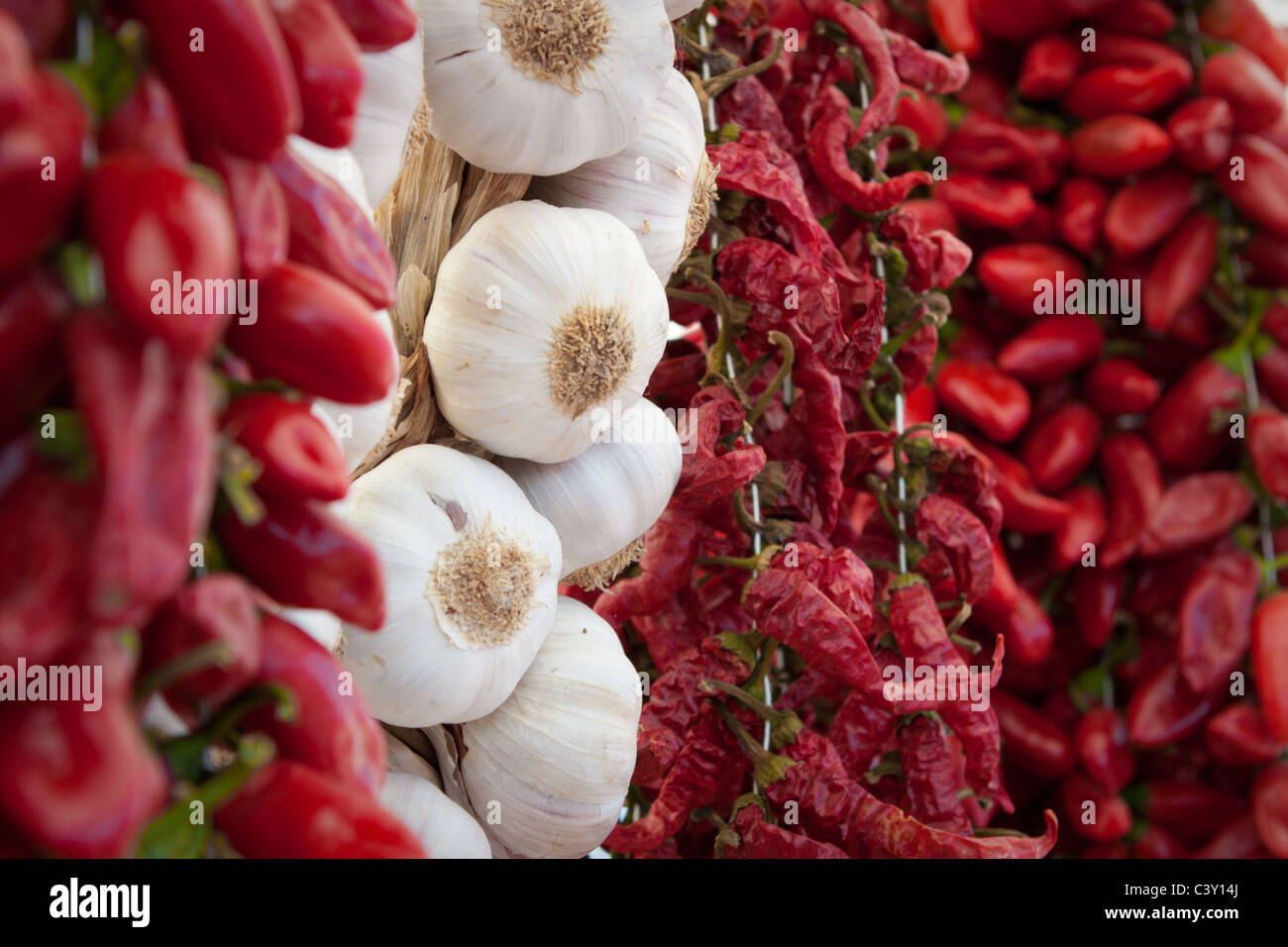 Peppers and garlic in market display - Stock Image