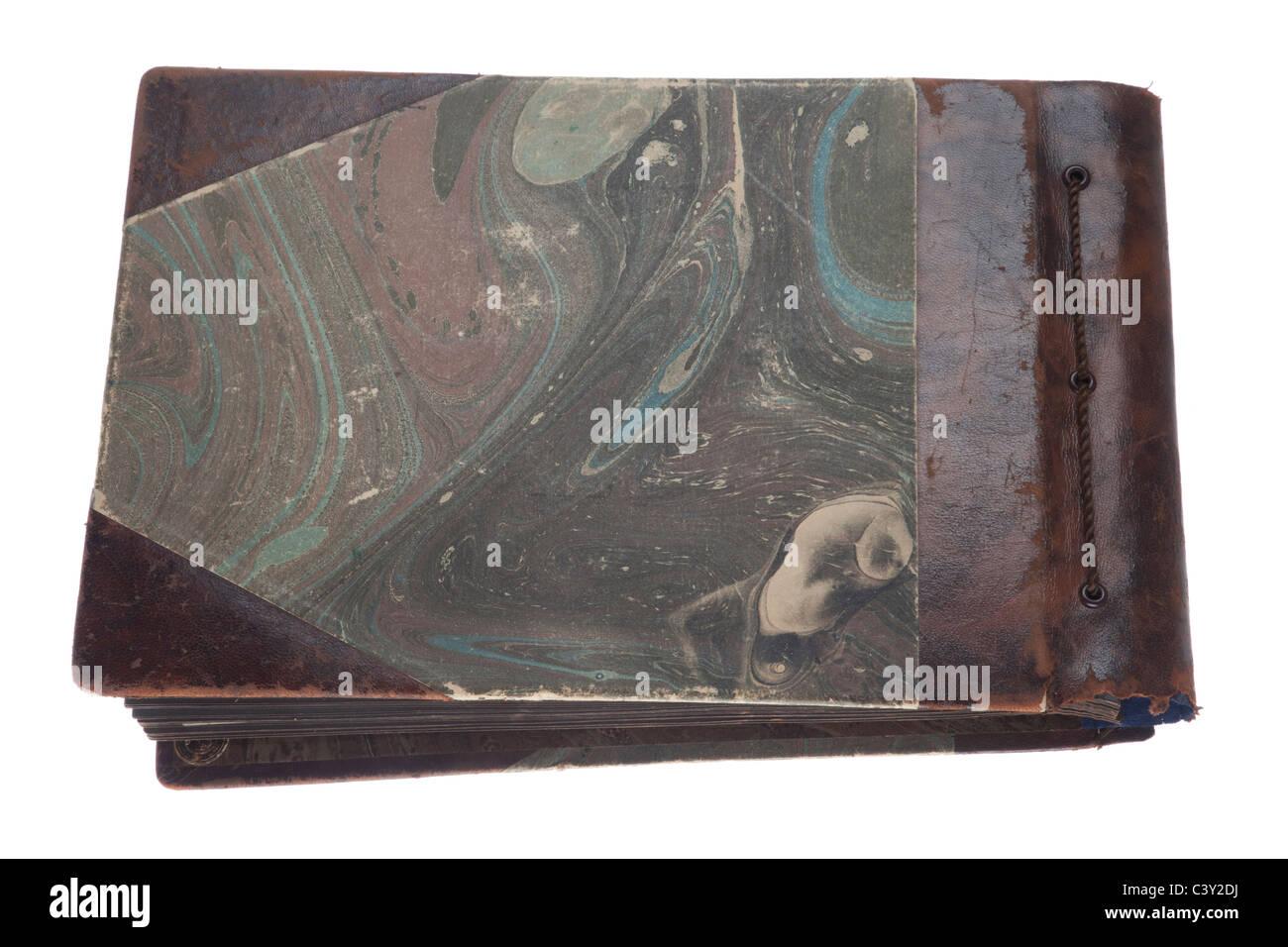 Old photo album with photos isolated on white. - Stock Image