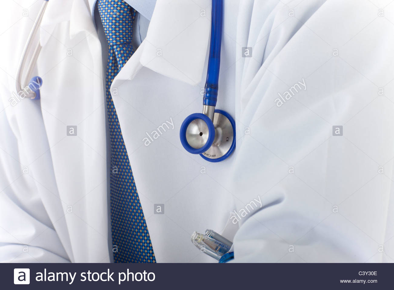 Close up of doctor's lab coat and stethoscope - Stock Image