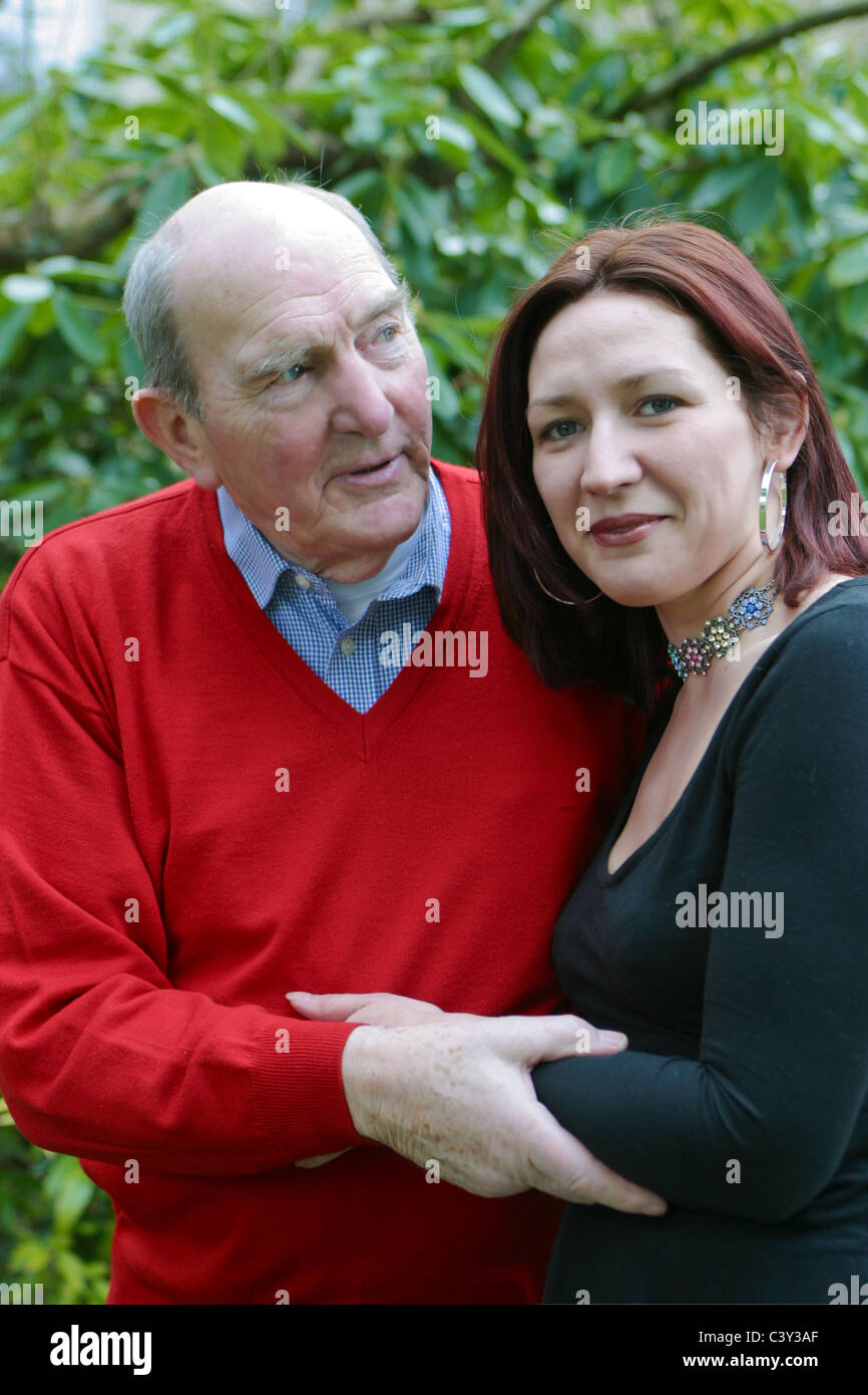 Woman looking after man older - Stock Image