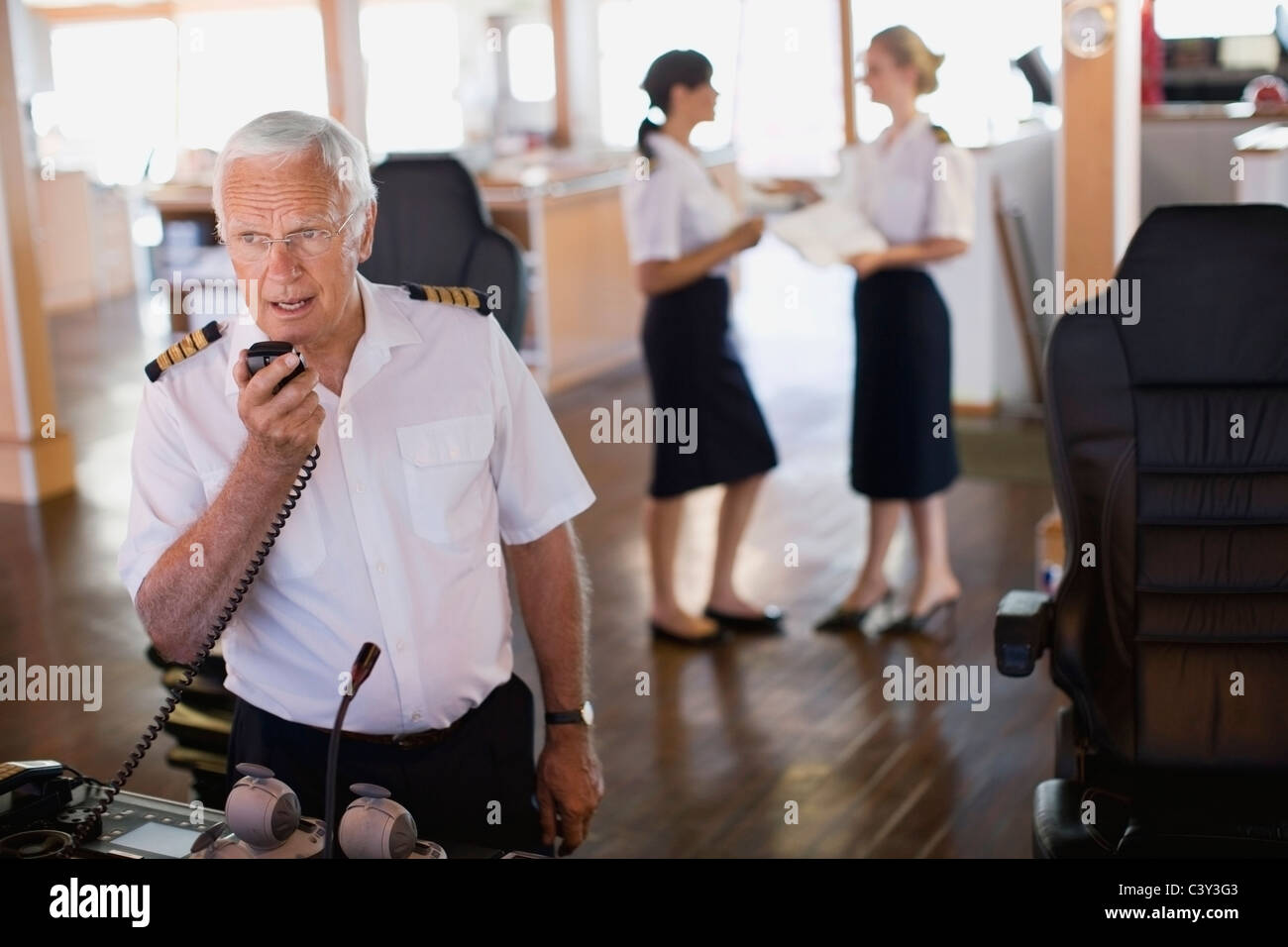 Captain doing a radio message Stock Photo