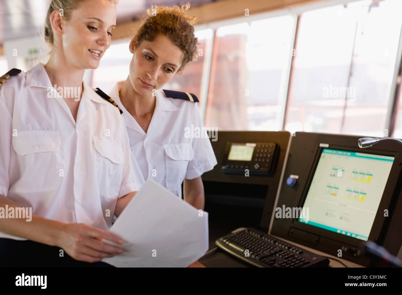 Female sailors doing their work - Stock Image
