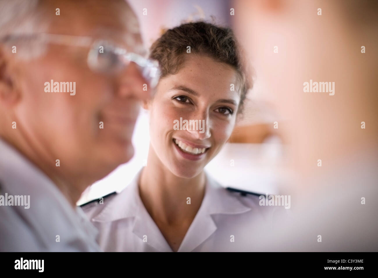 Crew of a ship talking - Stock Image