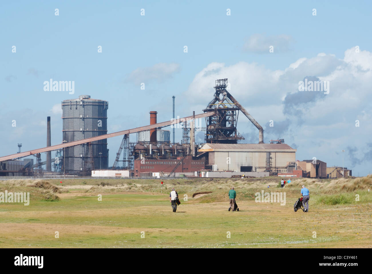 Redcar golf course with steelworks in background. Redcar, Cleveland, England, UK. - Stock Image