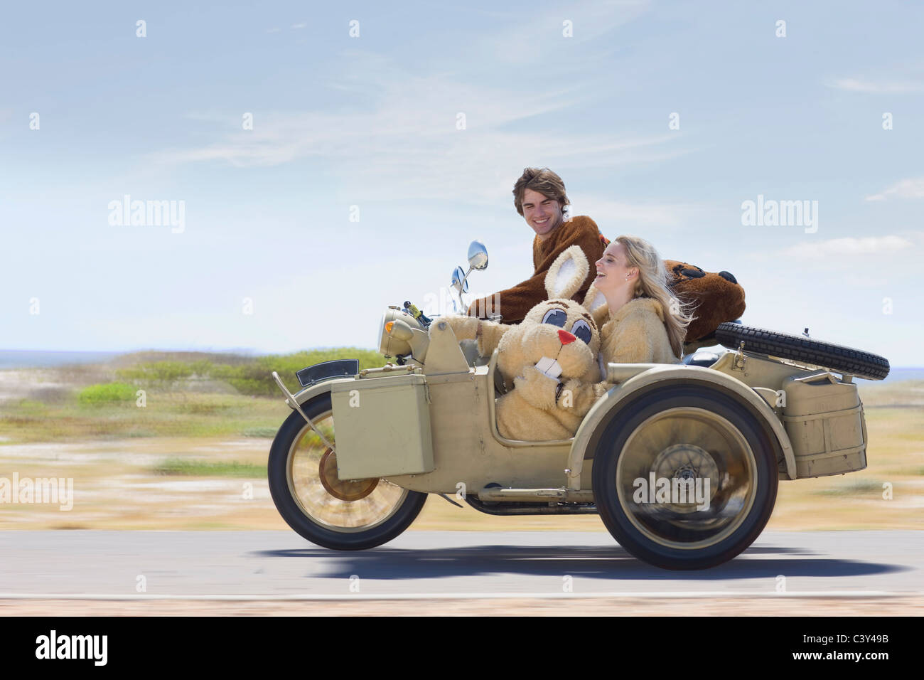 Disguised couple on motorbike Stock Photo