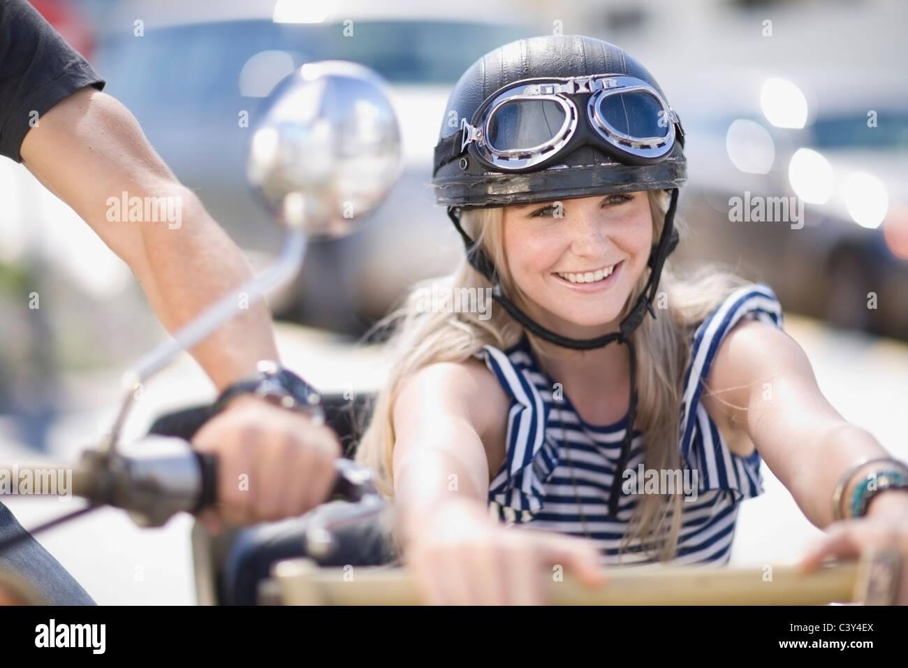 Woman on a motorbike - Stock Image