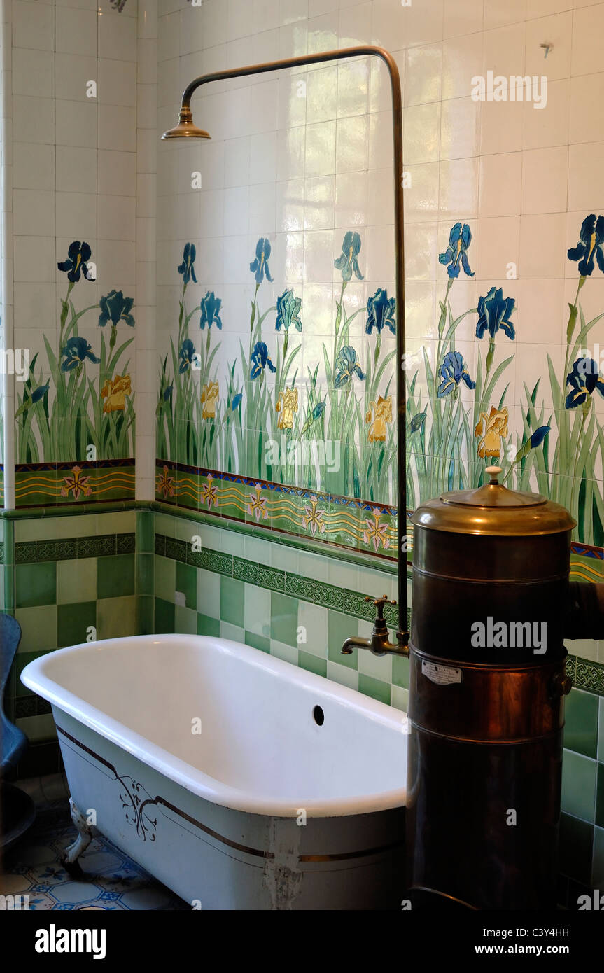 Old Bath & Tiled Bathroom with Old Solid Fuel Copper Hot Water Heater Villa Sapinière Museum Barcelonnette - Stock Image