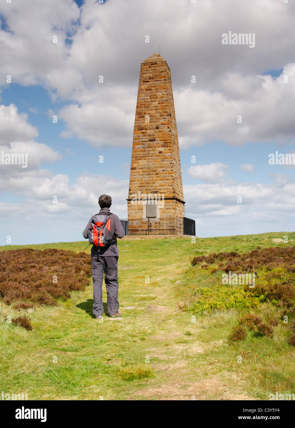 Male hiker near Captain Cook's monument on Easby moor near Great Ayton, North Yorkshire, England - Stock Image