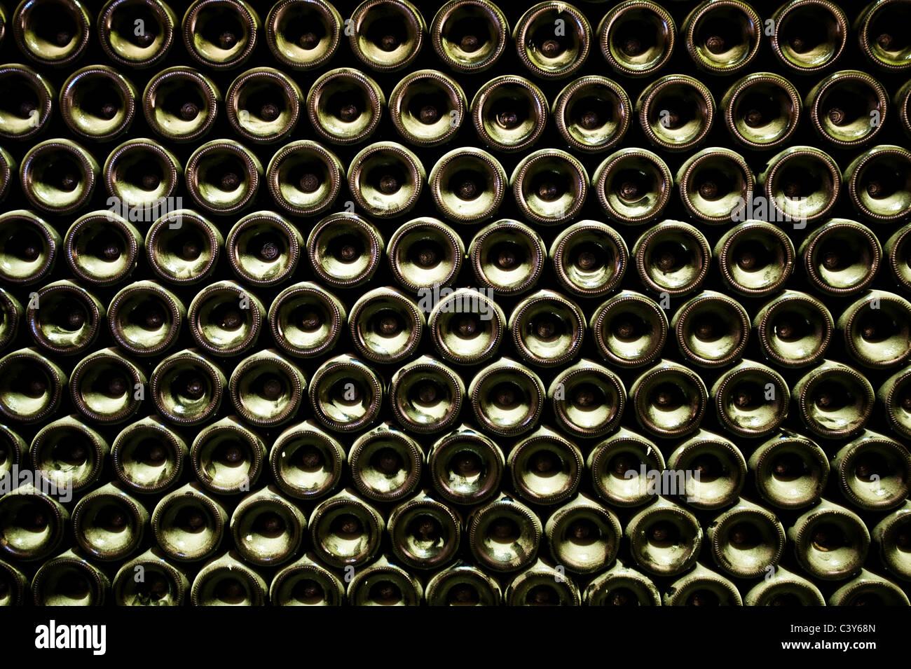 Stack of wine bottles, full frame - Stock Image