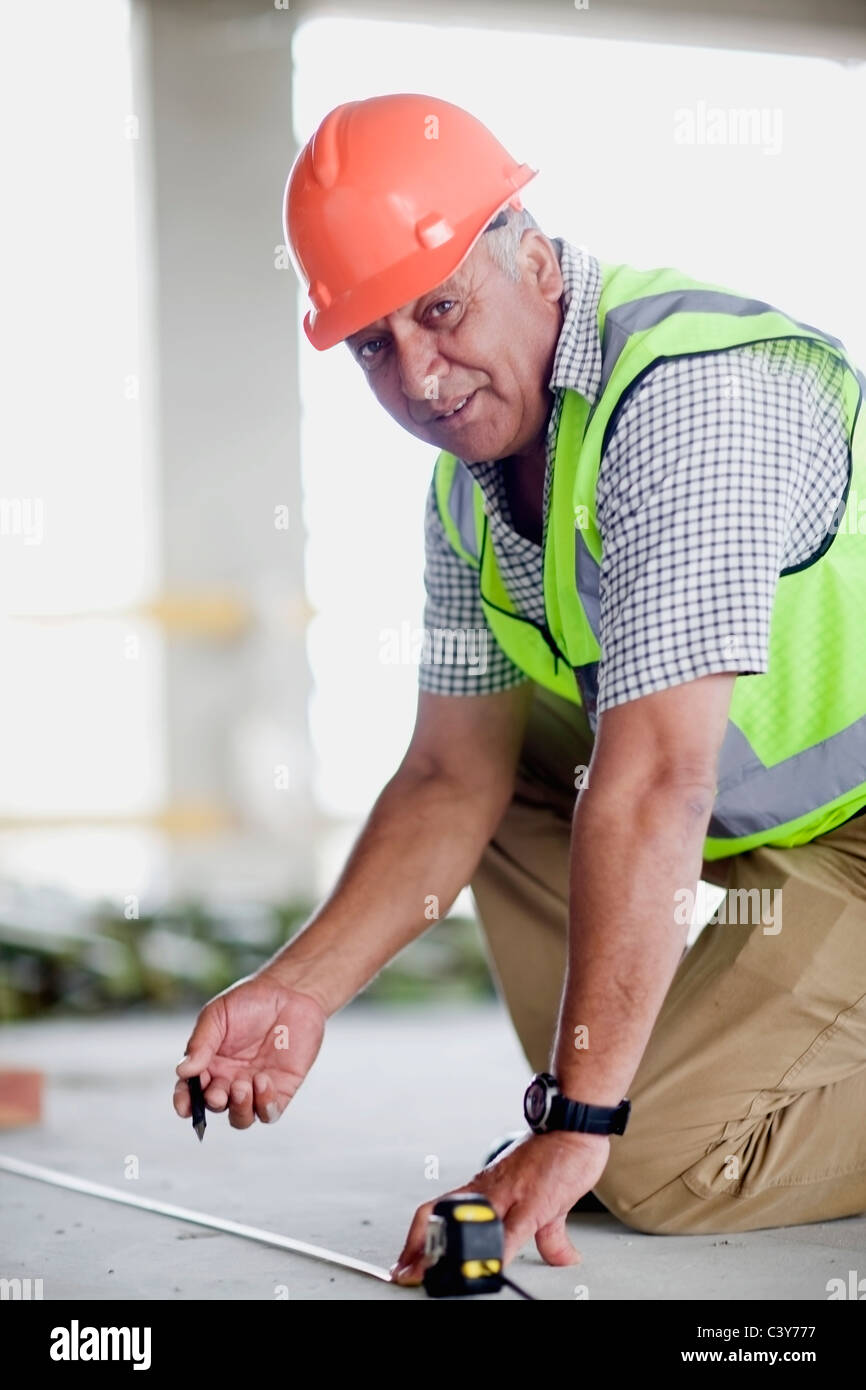 Older worker on construction site - Stock Image