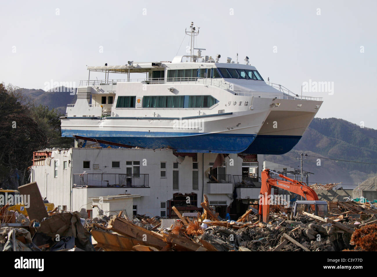 A sightseeing boat left on top of building afterTsunami wave gone ...