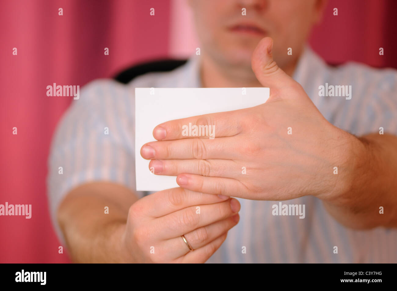 The man closes a hand card blank - Stock Image
