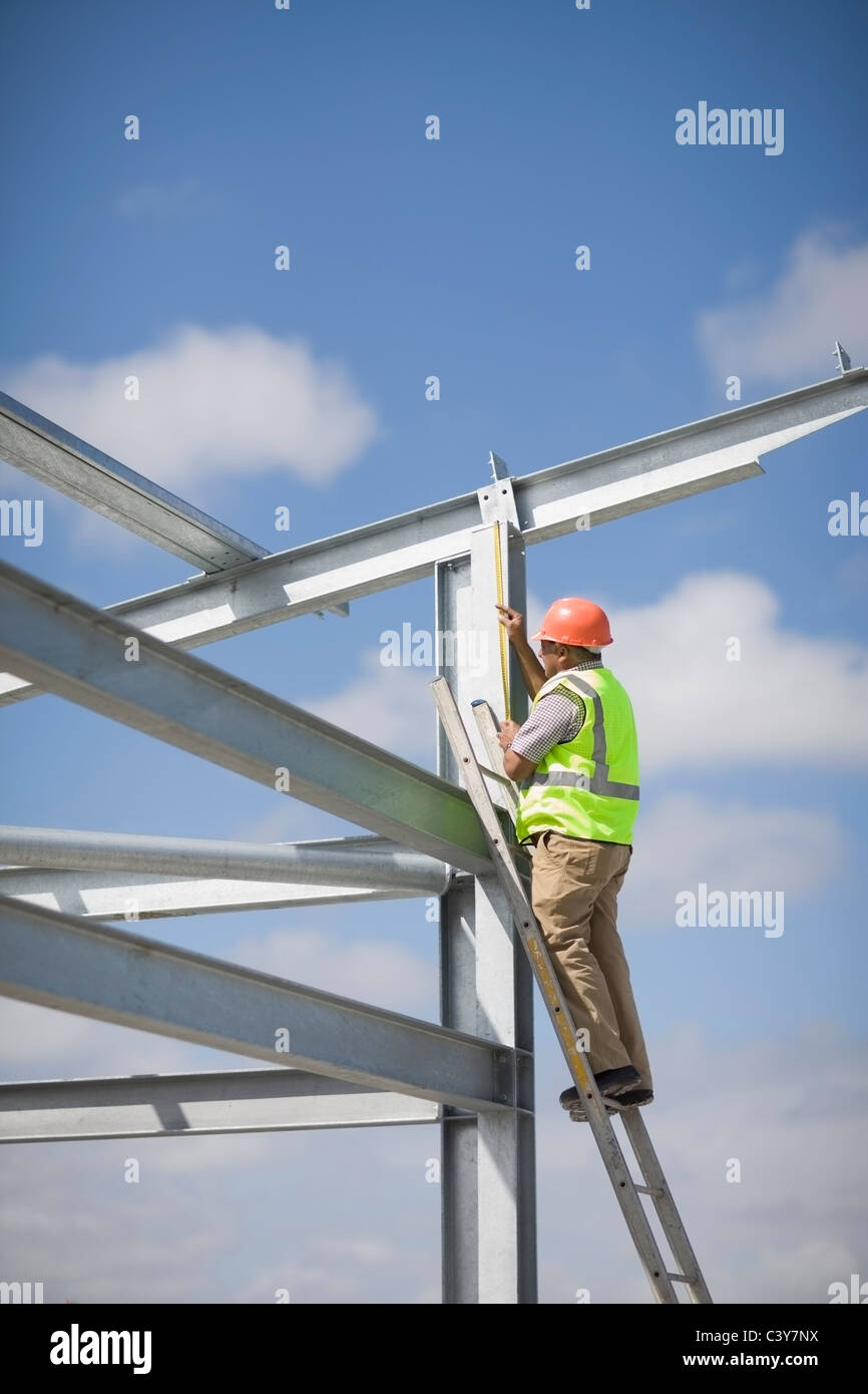 Worker inspecting a building plot - Stock Image