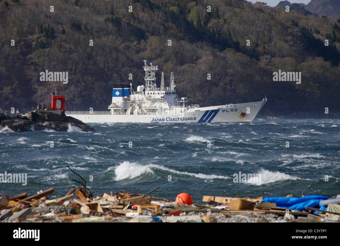 Japan Coast Guard ship PL-02 Erimo stays offshore Otsuchi-cho town Iwate Japan - Stock Image