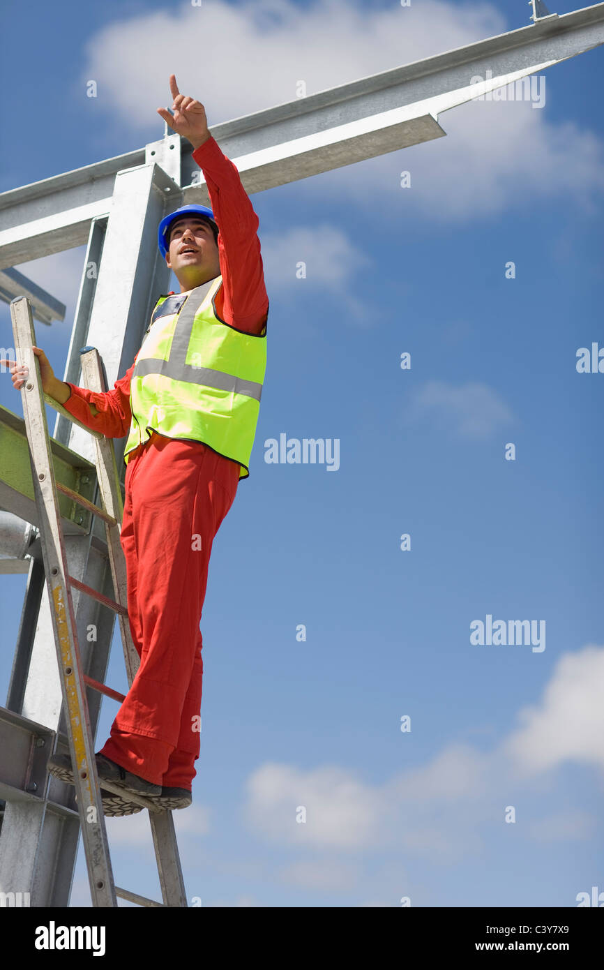 Worker inspecting the building plot - Stock Image