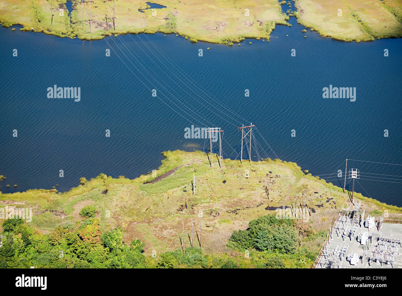 Power lines over water, Newport County, Rhode Island, USA - Stock Image