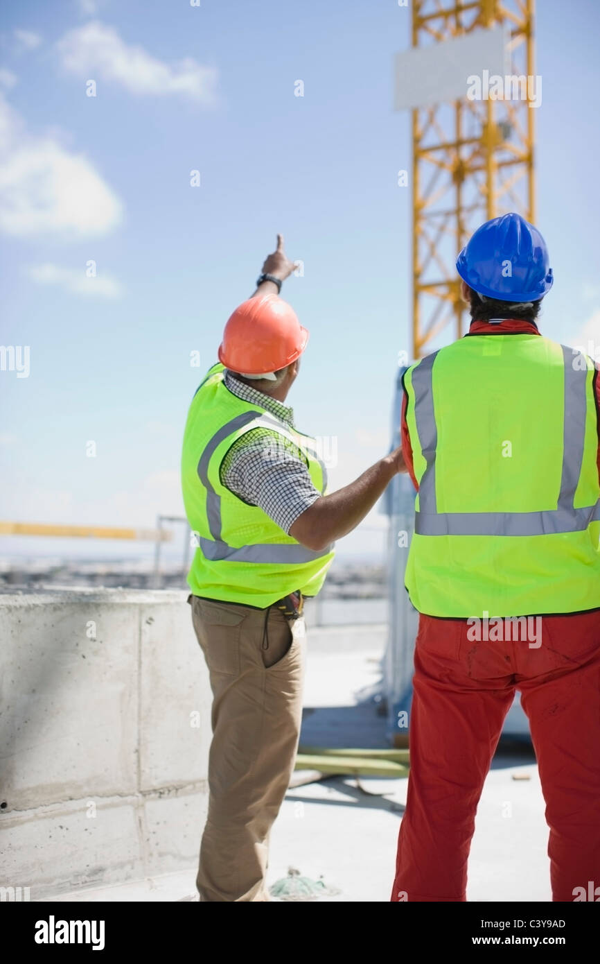 Workers inspecting a building plot - Stock Image